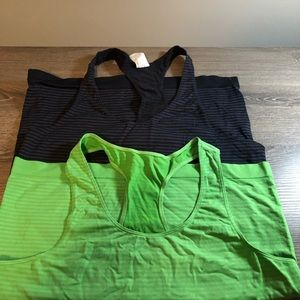 Two Under Armour tank tops, spandex